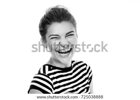 Happy young pretty woman laughing loudly over white background