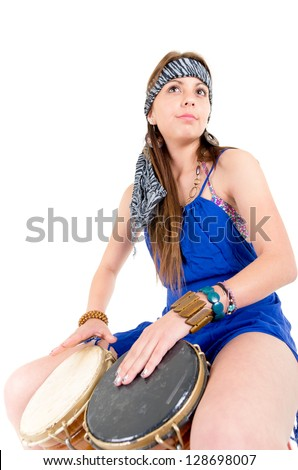 Happy young pretty woman smiling and playing bongos drum