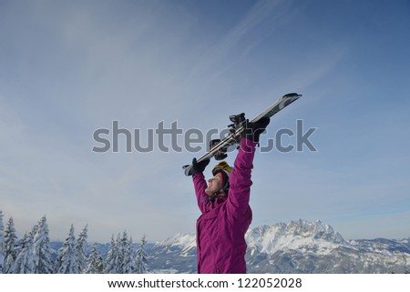 happy young ski woman at mountaint top on winter have fun - stock photo