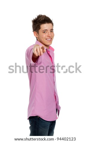Happy young smile boy pointing finger towards at you to the camera isolated on white background
