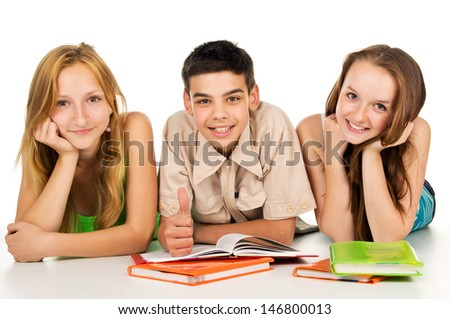 Happy young students with books