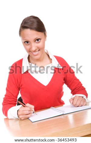 happy young teen learning at desk