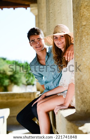 happy young teenager couple first love together in summertime during hot and sunny day