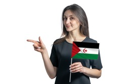 Happy young white woman holding flag Western Sahara and points to the left isolated on a white background.