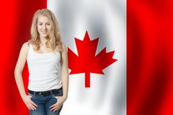 Happy young woman against the Canada flag background. Live, work, education and internship in Canada