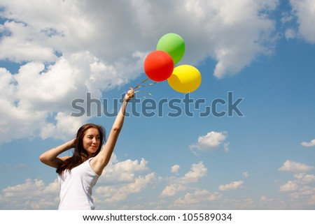 Happy young woman and colorful balloons