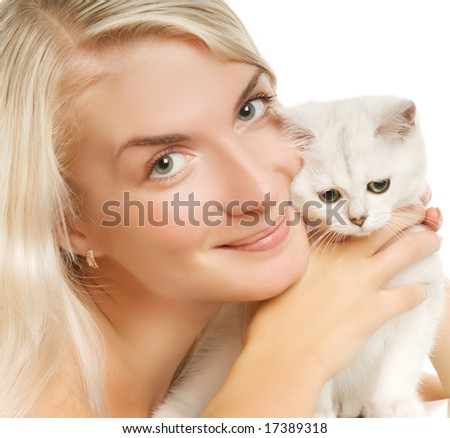 Happy young woman and sad british kitten