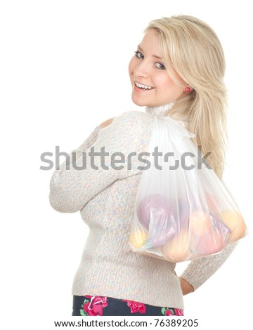 happy young woman and white, plastic shopping bag with fruits - stock photo