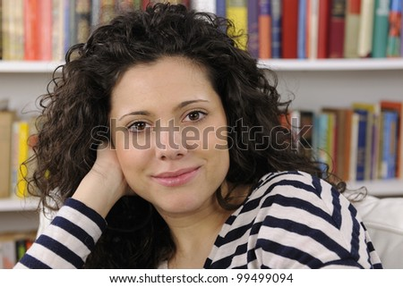 happy young woman at home smiling
