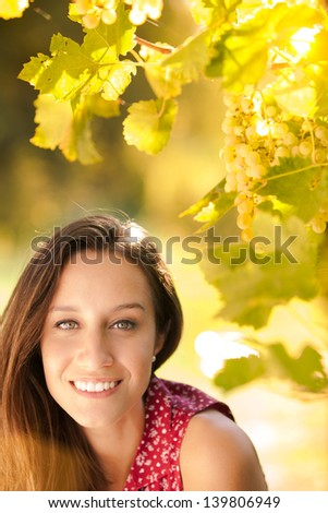Happy young woman at the sunset