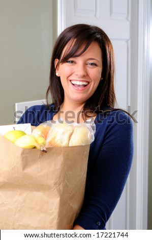 Happy Young Woman Carrying Her Groceries Into The House