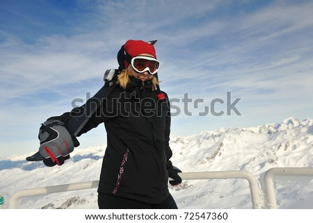 happy young woman have fan while relaxing at snow with ski and snowboard sport at winter seasonyoung athlete man have fun during skiing sport on hi mountain slopes at winter seasson and sunny day
