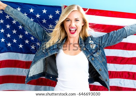 Happy young woman holding American flag