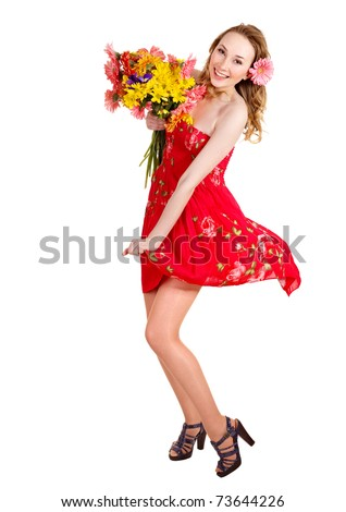 Happy young woman holding bunch of flowers. - stock photo