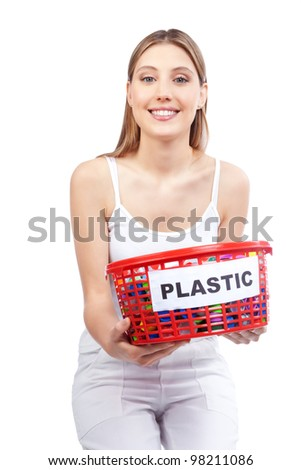 Happy young woman holding red basket in hand.