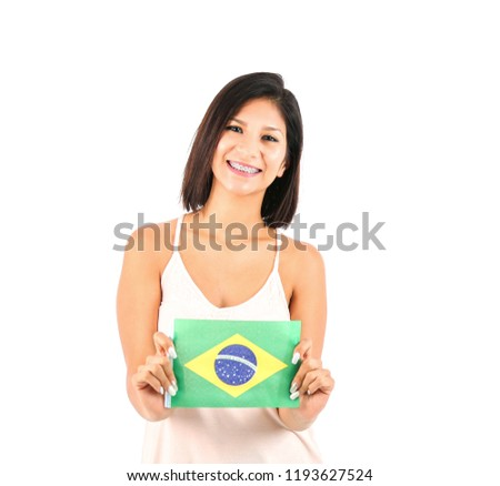 Happy young woman holding the flag of Brasil against a white background #1193627524