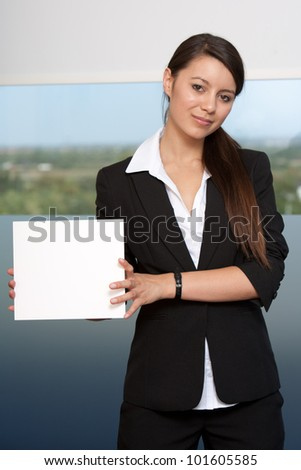Happy young woman holding white card sign - Add your text