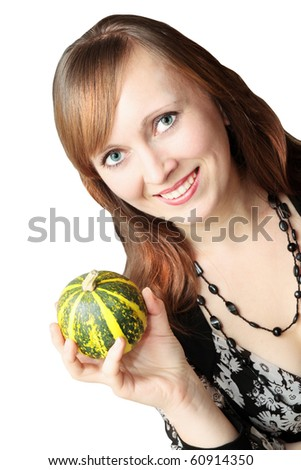 happy, young woman holds the decorative pumpkin