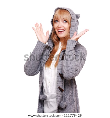 Happy young woman in a knitted cardigan surprised emotions
