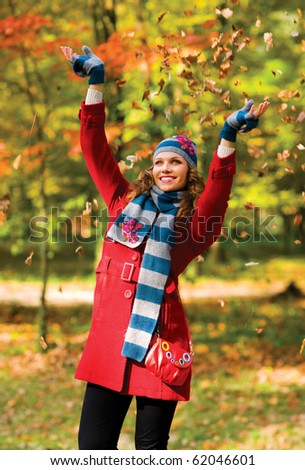 happy young woman in autumn scenery