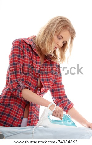 Happy young woman ironing on ironing board,isolated on white background.
