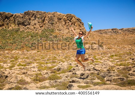 Happy young woman jumping on the beach. Freedom Concept #400556149