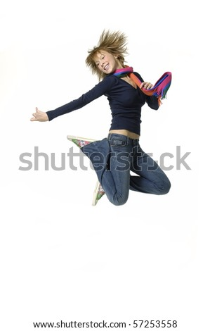 Happy young woman jumping on white