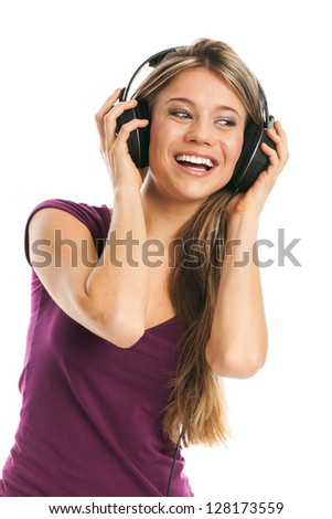 Happy young woman listening music with earphones, on white