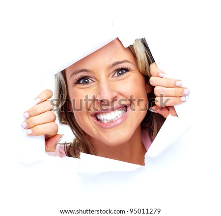 Happy young woman looking through a hole. Isolated on white background.