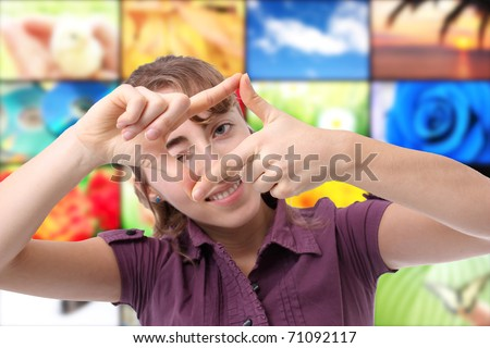 Happy young woman making a frame with her hand