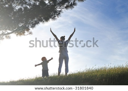 happy young woman mother play and outdoor with beautiful child - stock photo