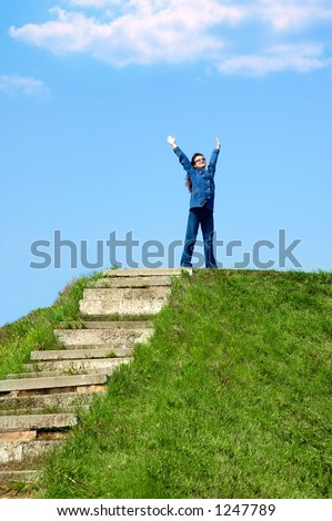 Happy young woman on a hill