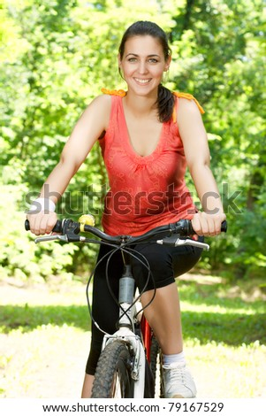 Happy young woman on bike.