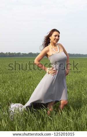 happy young woman outdoors in the field