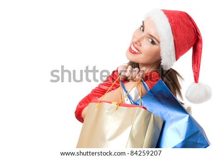 Happy young woman portrait in Christmas dress holding colorful present bags and looking at camera