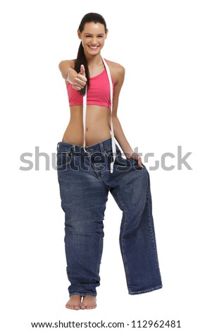 happy young woman posing in a big trousers