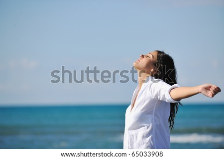 happy young woman relax onbeautiful  beach at morning - Shutterstock ID 65033908