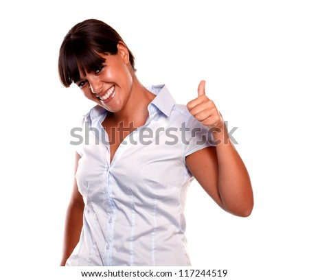 Happy young woman saying great job looking at you on blue shirt against white background