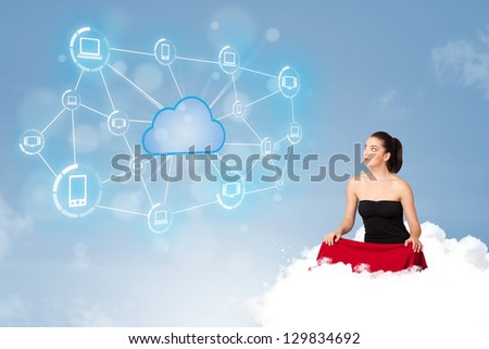 Happy young woman sitting on cloud with cloud computing
