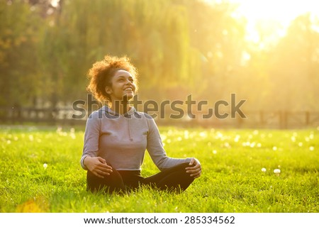 happy young woman sitting...