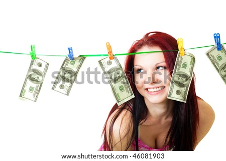 Happy young woman stand and look at rope with us dollars
