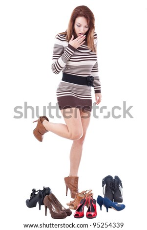 Happy young woman surrounded by all of her shoes