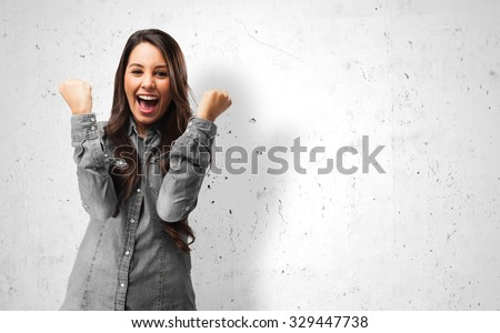 Shutterstock happy young woman victory sign