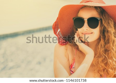 happy young woman wearing...