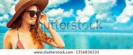 Happy young woman wearing swimsuit at tropical sand beach resort in summer for holiday travel vacation. #1356836531