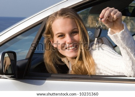 happy young woman with new car - stock photo