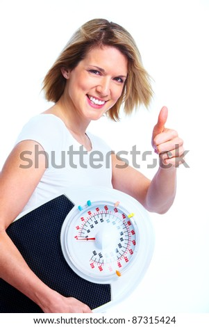Happy young woman with scales. Weight loss. Isolated over white background. - stock photo