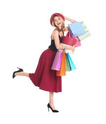 Happy young woman with shopping bags and boxes on white background