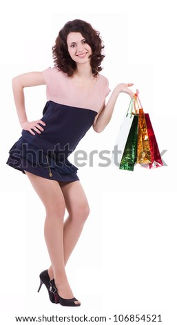 Happy young woman with shopping bags isolated on a white background
