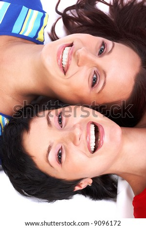 Happy young women friends laughing.  Over white background